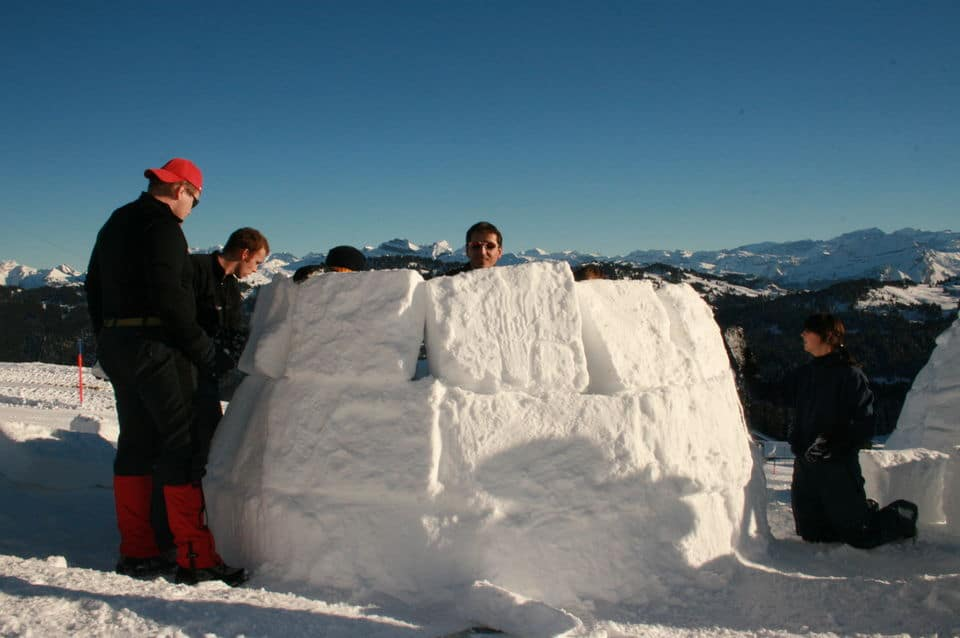 Igloo Building With House-Warming Party