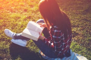 Reading A Book In The Park