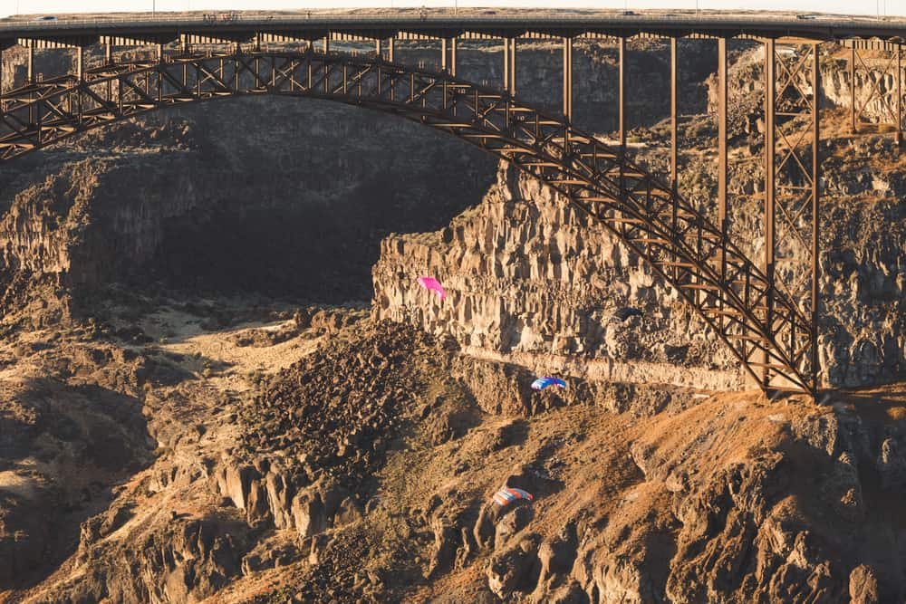 Base Jumpers Parachuting in the Snake River Canyon
